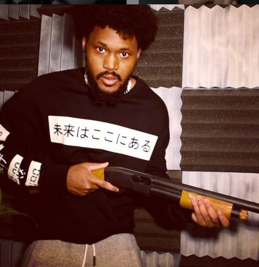 CoryxKenshin holding a gun