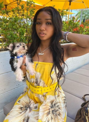 Dy'mond Charleston with pet