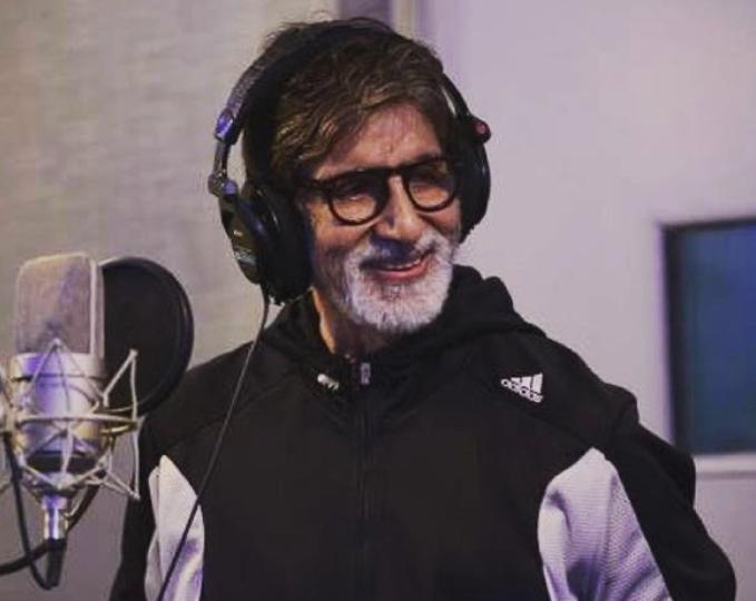 Amitabh Bachchan singing in a studio