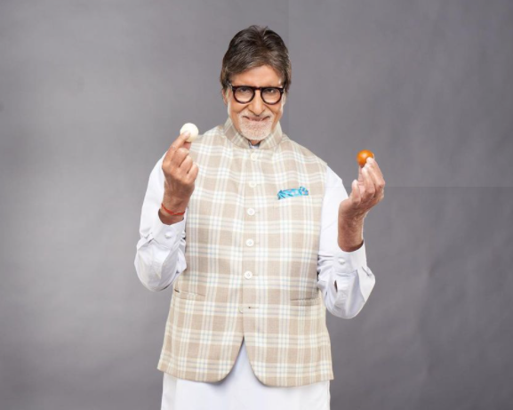 bachchan holding sweets in his hands