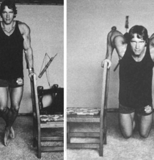 Arnold schwarzenegger working out at his gym