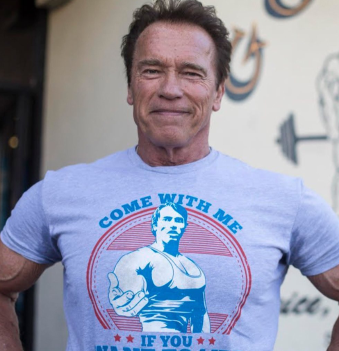 Arnold schwarzenegger posing for a photo