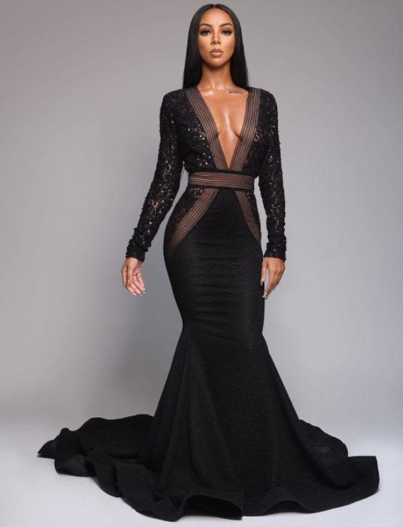 Brittany renner posing in black gown