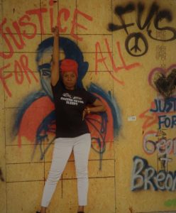 juanita jennings wearing tshirt and protesting against racism