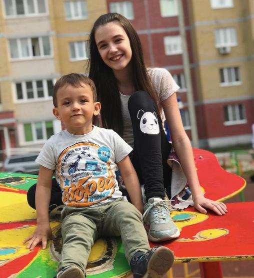 kristina pakarina with her brother