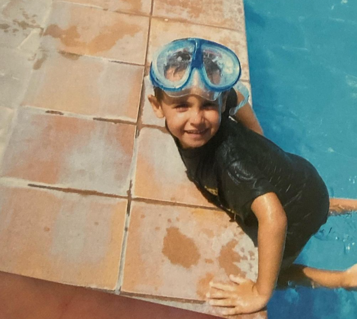 little Kyle Thomas swimming