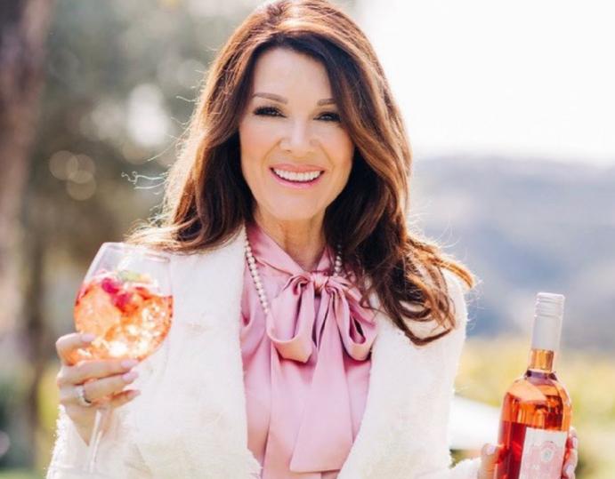 Lisa vanderpump with bottle of wine